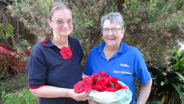 Margaret Doecke of Country Fabric's 'N' Things presents Jenny with Poppies for Gustav Trail 2018